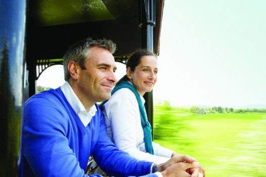 Belmond Roya Scotsman-Close up of couple enjoying the view from open verandah ©Matt Hind